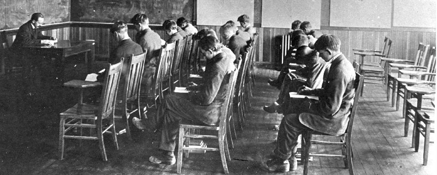 Student and pupils sit in English class from the early 20th century